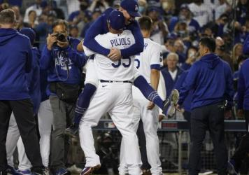 The Los Angeles Dodgers celebrate after Chris Taylor hit a home run during the ninth inning to win a National League Wild Card playoff baseball game 3-1 over the St. Louis Cardinals Wednesday, Oct. 6, 2021, in Los Angeles. Cody Bellinger also scored.
