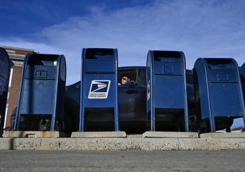 The Postal Service says the predicted slowdown is caused in part by the agency's decision to rely less on moving mail by air and more by ground transportation.