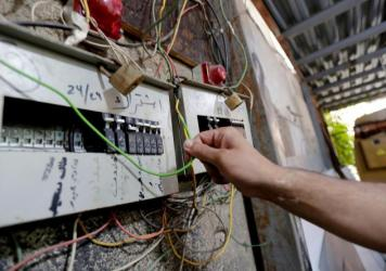 A picture taken on November 4, 2019, shows a circuit breaker of an electric generator supplying homes with electricity in the Lebanese capital Beirut's southern suburbs.