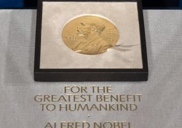 """Displayed is a file photo of a Nobel Prize medal on Dec. 8, 2020. The Nobel Prize in economic sciences was awarded to three U.S-based professors for their pioneering work with """"natural experiments."""""""