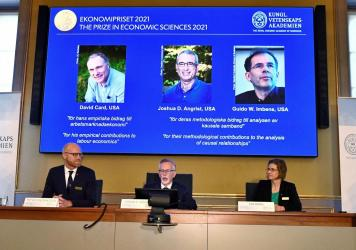 Goran K. Hansson (C), Permanent Secretary of the Royal Swedish Academy of Sciences, and Nobel Economics Prize committee members Peter Fredriksson (L) and Eva Mork (R) give a press conference to announce the winners of the 2021 Sveriges Riksbank Prize in