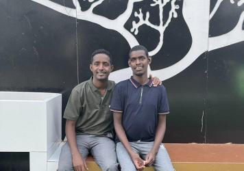 Omar Mohamed, left, and his brother, Hassan. In the graphic memoir he coauthored, <em>When Stars Are Scattered, </em>Mohamed shares what their life was like in the refugee camps in Kenya — and their journey to resettlement in the U.S.