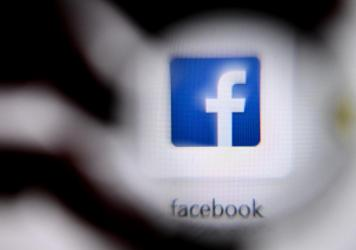 The U.S. online social media and social networking service Facebook's logo is shown on a laptop screen. Facebook has announced changes to its policies on online bullying.
