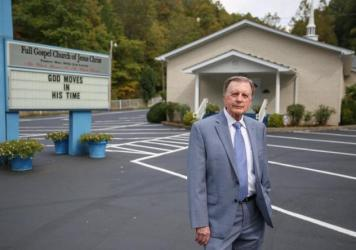"""Pastor Billy Joe Lewis was all in favor when a local health worker suggested a COVID-19 vaccine clinic in the parking lot of his church in Smilax, Ky. """"We've still got to use common sense,"""" Lewis says. """"Anything that can ward off suffering and death, I t"""