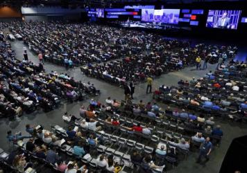 In this June 16, 2021, file photo, people attend the morning session of the Southern Baptist Convention annual meeting in Nashville, Tenn.