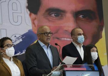 Venezuelan President of the National Assembly Jorge Rodriguez, center, speaks to the press as an image of Colombian businessman and Venezuelan special envoy Alex Saab is in the back in Caracas, Venezuela, Saturday, Oct 16, 2021.