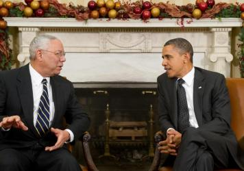 President Barack Obama speaks with former Secretary of State Colin Powell in the Oval Office on Dec. 1, 2010. Powell, who had broken his longtime Republican ties to endorse Obama in 2008, died Monday.