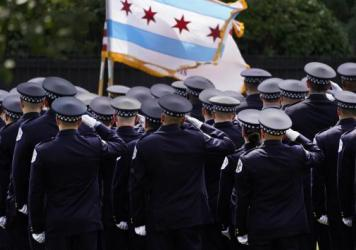 Chicago police officers salute the state flag on Aug. 18.