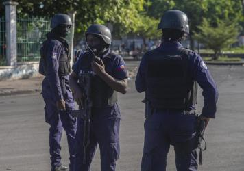Armed forces secure the area where Haiti's Prime Minister Ariel Henry placed a bouquet of flowers in front of a memorial to independence hero Jean-Jacques Dessalines in Port-au-Prince, Haiti, on Sunday. Haitian police are working with U.S. officials and