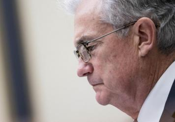 Federal Reserve Chairman Jerome Powell testifies at a House Financial Services Committee hearing on Capitol Hill in Washington, D.C., on Sept. 30. The Fed announced new restrictions on investments by senior officials after being rocked by a controversy i