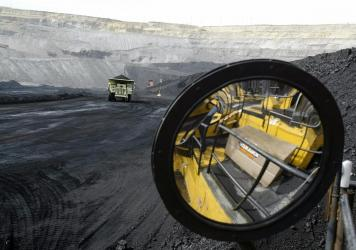 A coal-hauling truck with 240 tons of coal drives to the surface at the Buckskin Coal Mine in Gillette, Wyo., in 2004.