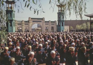 Xining's Dongguan Mosque has been a source of community for Chinese Muslims for seven centuries. Here, Hui Muslim men pray in the mosque in 1983.