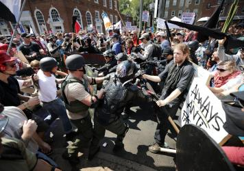"""White nationalists, neo-Nazis and members of the """"alt-right"""" clash with counter-protesters as they enter Emancipation Park during the """"Unite the Right"""" rally August 12, 2017 in Charlottesville, Virginia."""