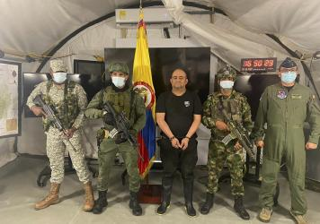 """In this photo released by the Colombian presidential press office, one of the country's most wanted drug traffickers, Dairo Antonio Usuga, alias """"Otoniel,"""" leader of the violent Clan del Golfo cartel, is presented to the media at a military base in Necoc"""