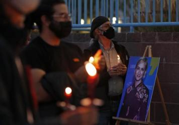 New Mexico residents attend a candlelight vigil to honor cinematographer Halyna Hutchins in Albuquerque, N.M. Saturday, Oct. 23, 2021. Hutchins was fatally shot on Thursday on the set of a Western filmed in Santa Fe, N.M.