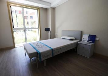 Unvaccinated people who arrive in China for the Beijing Olympcs will face isolation in a mandatory three-week quarantine. Here, a room is seen in the athletes village in Zhangjiakou, China.