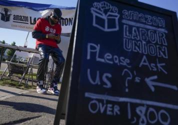 Chris Smalls, who runs the self-organized worker group Amazon Labor Union, has been gathering signatures from Amazon warehouse workers on Staten Island in support of a union election.