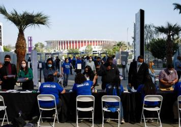 Los Angeles International Airport and SoFi Stadium employers spoke with potential job applicants at a job fair in Inglewood, Calif., in September. About 19% of all households in an NPR poll say they lost all their savings during the COVID-19 outbreak, an