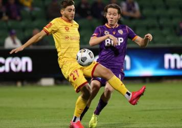 Josh Cavallo of Adelaide, left, and Daniel Stynes of the Glory contest for the ball during the A-League match between Perth Glory and Adelaide United at HBF Park, on May 19 in Perth, Australia.