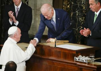 Then-Vice President Biden shakes hands with Pope Francis on Capitol Hill in Washington, prior to the pope's address to a joint meeting of Congress in 2015. On Friday, Francis will welcome Biden to the Vatican for the first time since Biden took office, b