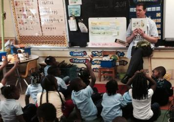 Thomas O'Donnell reads about Twiggle the Turtle to his kindergartners at Matthew Henson Elementary School in Baltimore.
