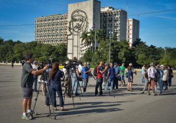 Journalists wait for Cuban performance artist Tania Bruguera at Revolution square in Havana, on Wednesday.