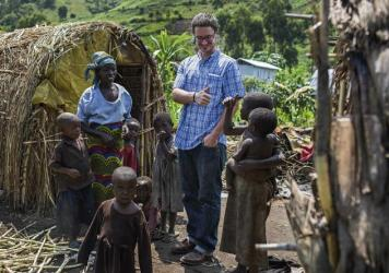 Michael Sharp visits with Elizabeth Namavu and children in Mubimbi Camp, home to displaced persons in the Democratic Republic of Congo. A coordinator for the Mennonite Central, he has an unusual approach to peacemaking.