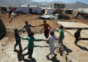 Syrian children play at a refugee camp in Terbol, Lebanon, in 2013. More than 1 million Syrian refugees are in Lebanon, which is now requiring Syrians to obtain visas before entering the country.