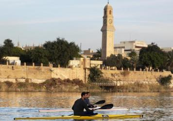 Young members of the Baghdad Rowing Club practice on the river Tigris, close to the University of Mustansiriyah in the Iraqi capital.