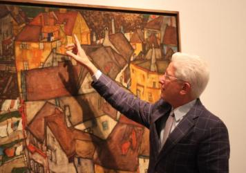 James Snyder, director of the Israel Museum in Jerusalem, with Egon Schiele's 1915 work, Krumau Town Crescent I. It's one of about 1,000 works of Nazi-confiscated art the museum has received. The museum has no record of who owned the painting before it w