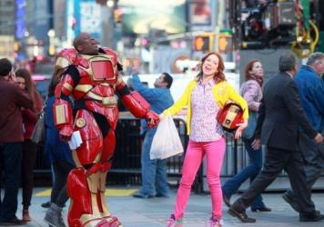 Actors Tituss Burgess and Ellie Kemper horse around on the set of <em>The Unbreakable Kimmy Schmidt</em> while filming in New York in March. Tina Fey's new TV series<em> </em>was developed for NBC, but will air on Netflix instead.