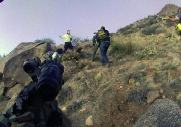 An image taken from a camera worn by an Albuquerque Police Department officer shows a standoff with James Boyd in the Albuquerque foothills, in March of 2014. Two officers will face murder charges over Boyd's death.