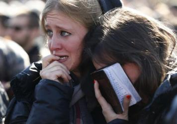 Mourners in Jerusalem cry during the funeral of four Jews killed in an attack on a kosher supermarket in Paris last week.