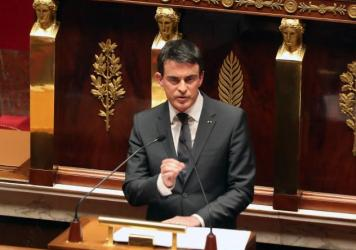 French Prime Minister Manuel Valls delivers his speech during an homage to the 17 victims of last week terrorist attacks, at the French national Assembly in Paris on Tuesday.