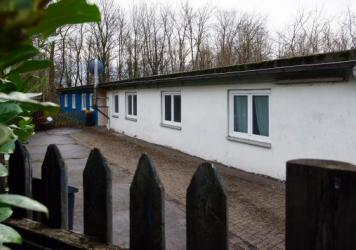 The warden's barracks at a satellite camp of the Buchenwald concentration camp in Schwerte, Germany, on Jan. 13. According to media reports, the city has proposed housing around 20 refugees in buildings at the camp. The move has drawn protests in Germany