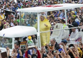 """Pope Francis waves to the crowd as he arrives at Quirino Grandstand to celebrate his final Papal Mass in Manila, Philippines, on Sunday. In his homily, Francis warned about the Philippine government's """"insidious"""" family planning program."""