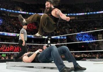 "WWE fighter Bray Wyatt, ""The Eater Of Worlds,"" jumps on fighter ""Dean Ambrose."""