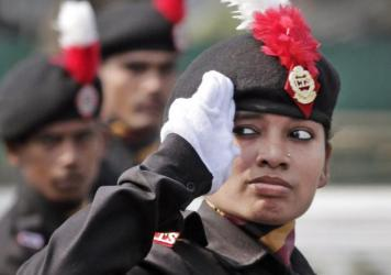 A National Cadet Corps cadet walks past the saluting base during the full dress rehearsal for Republic Day parades in Kolkata, India, on Saturday. President Obama will be the chief guest at the parade.