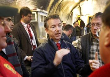 Sen. Rand Paul, R-Ky., center, meets with members of the Londonderry Fish and Game Club in Litchfield, N.H., on Jan. 14. Paul was one of three GOP presidential hopefuls who attended Sunday's semiannual gathering of David and Charles Koch's donor network