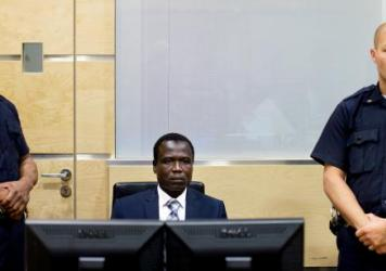 Dominic Ongwen, a Ugandan commander in warlord Joseph Kony's feared militia, waits for procedures to start at the International Criminal Court in The Hague, Netherlands, on Jan. 26.
