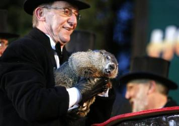 Groundhog Club handler Ron Ploucha holds Punxsutawney Phil, the weather prognosticating groundhog, during the 129th celebration of Groundhog Day on Gobbler's Knob in Punxsutawney, Pa., on  Monday. Phil saw his shadow, predicting six more weeks of winter