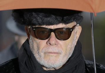 British pop star Gary Glitter, real name Paul Gadd, arrives at Southwark Crown Court in London, on Thursday. A jury convicted Glitter, born Paul Gadd, of sex offences in the 1970s and '80s against girls between the ages of 8 and 13.