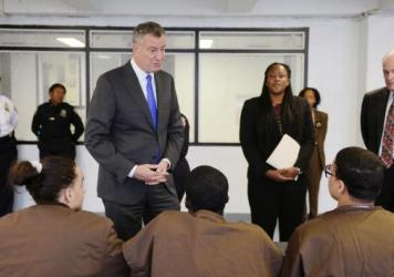 New York Mayor Bill de Blasio tours and meets with youth Dec. 17 at Second Chance Housing on Rikers Island in New York City. Second Chance Housing is an alternative for incarcerated adolescents, instead of punitive segregation, also known as solitary con