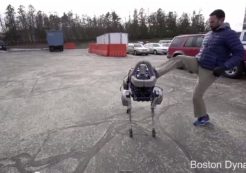 A Boston Dynamics robot called Spot is kicked by a human.