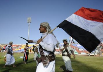 Supporters of Houthi Shiites, who took over the government of Yemen and installed a new committee to govern, dance with traditional daggers at a rally in support of the Houthis, at a sports stadium in Sanaa, Yemen, Saturday, Feb. 7, 2015.