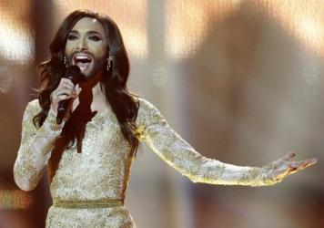 """Singer Conchita Wurst, representing Austria, performs the song """"Rise Like a Phoenix"""" during the final of the Eurovision Song Contest in Copenhagen, Denmark. Wurst, who won the competition, placed seventh on Google's list of 2014's fastest-rising global s"""
