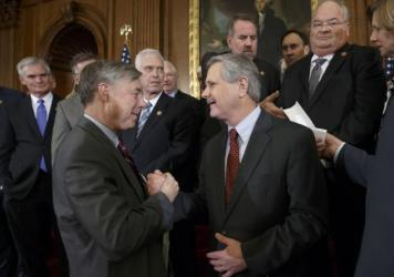 House Energy and Commerce Committee Chairman Fred Upton, R-Mich., left, clasps hands with Sen. John Hoeven, R-N.D., sponsor of the Senate's Keystone XL pipeline bill version, on Wednesday as lawmakers gather to urge President Obama to sign the legislatio