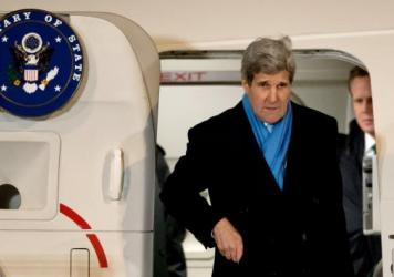 Secretary of State John Kerry arrives at the airport in Munich, Germany, on Feb. 5. On the way back to the U.S., Kerry's plane stopped in Boston during a snowstorm so he could see his new grandchild. Such personal stops are permitted, though they sometim