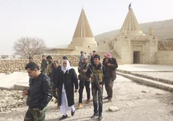 "The stone pillar at the center of this temple is where Yazidi worshippers bring their prayers. ""During the siege, we came here every day and asked God to save us,"" says a fighter named Shamwa Edo."