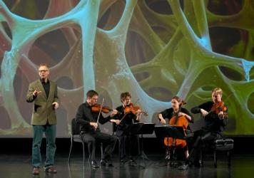 """Robert Davies (standing) and the quartet during a performance of """"The Crossroads Project."""" Musicians include (left to right) Robert Waters, Rebecca McFaul, Anne Francis Bayless and Bradley Ottesen."""